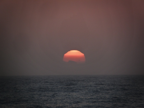 See the fog layers bent around the sun!