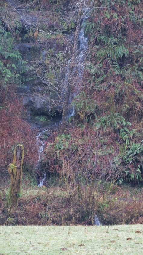 Waterfall - zoomed across a field and river