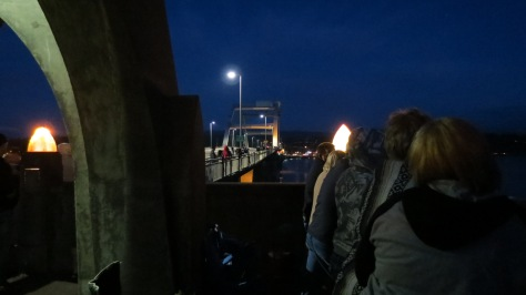 People line Alsea Bridge