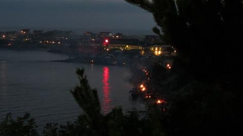 Campfires line Alsea Bay